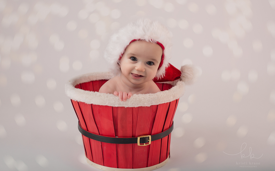 6 month baby boy in santa basket with santa hat