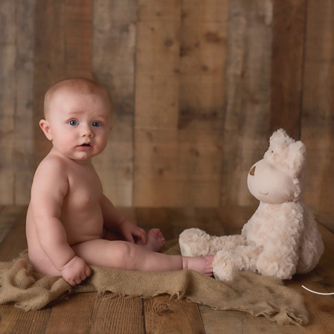 6 month old baby with teddy beat photo