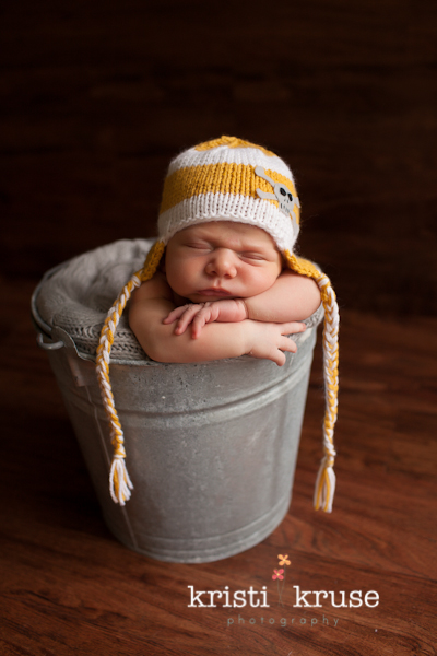 Newborn in a bucket shot · holly springs baby photographer · newborn baby pose